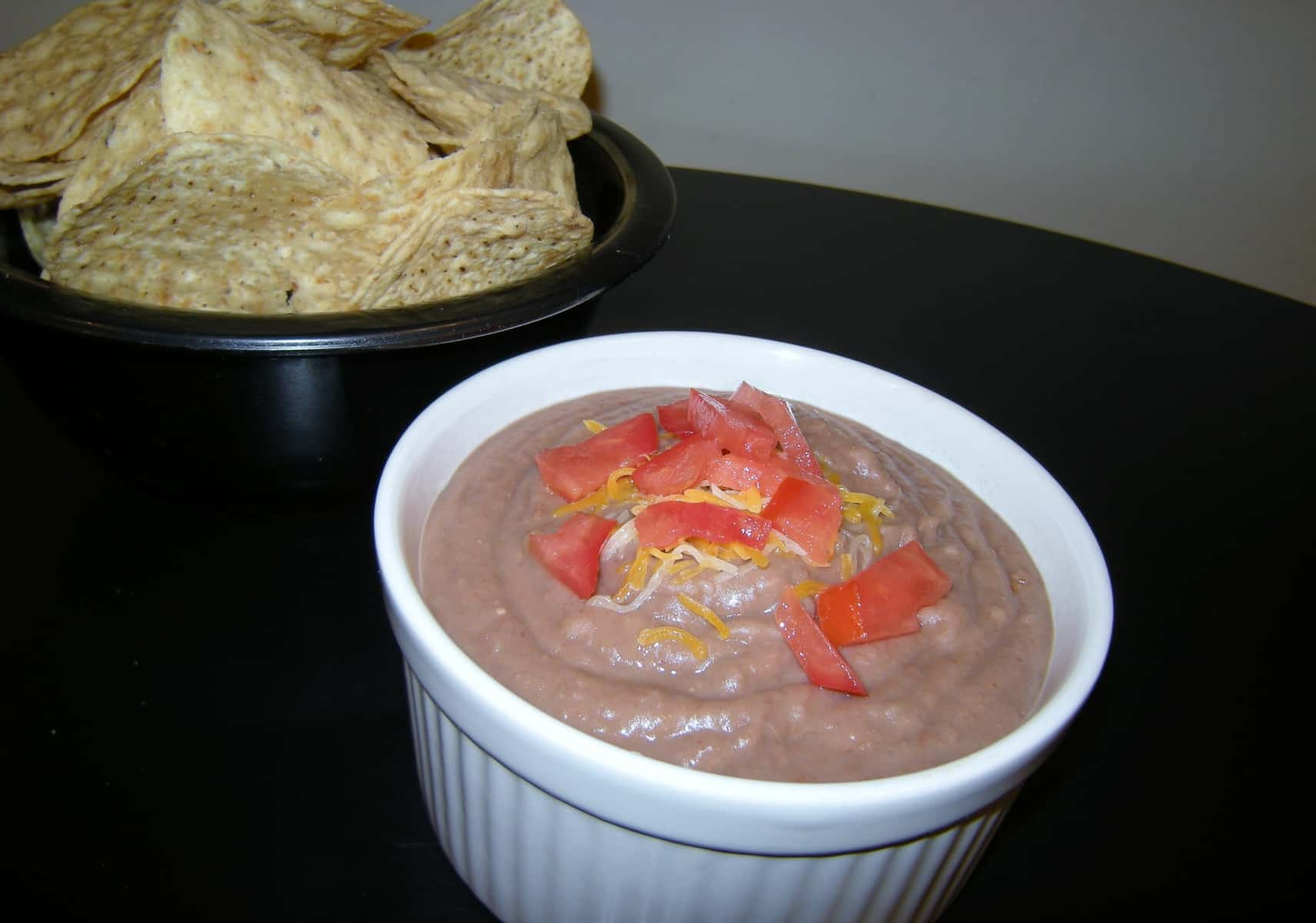 serve crock pot bean dip with nacho chips