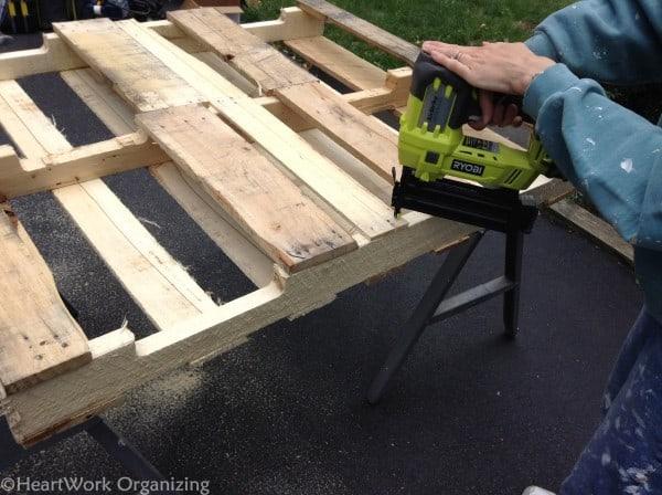 using nail gun to make lemonade stand from pallets