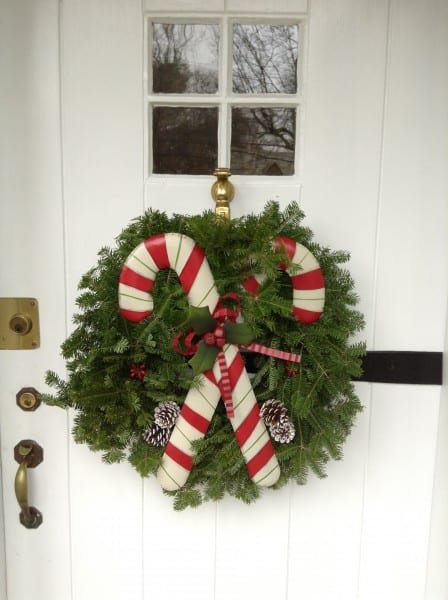 holiday wreath with metal candy cane accent