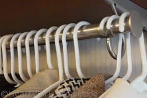 backwards hanger trick to purge when organizing closet