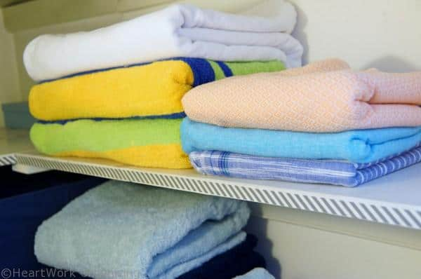 towels,  organize the linen closet