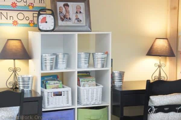 homework, books, and supplies under the loft