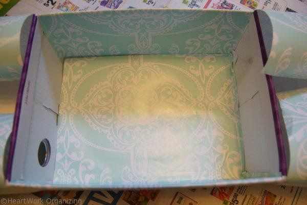 wrapping the inside of a box for organizing