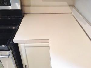 faux granite film kitchen corner before