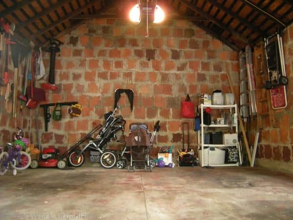 organized garage with terra cotta tile construction