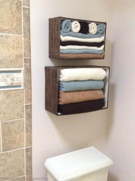 Basket with towels mounted above toilet