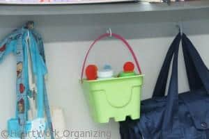 use cup hooks to organize toys