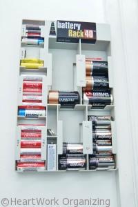 battery organizer stored near kids toys