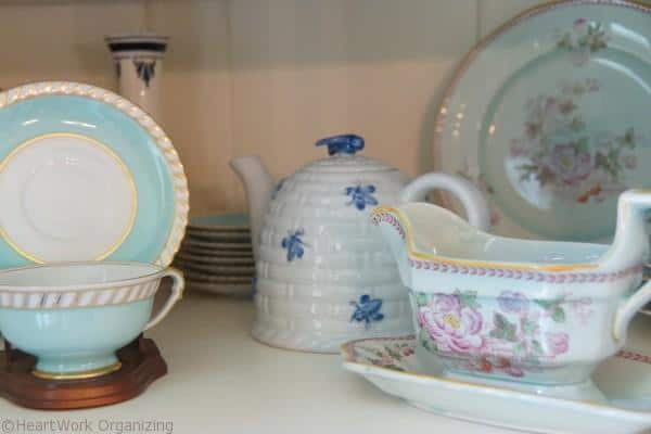 how to display cups in a china cabinet