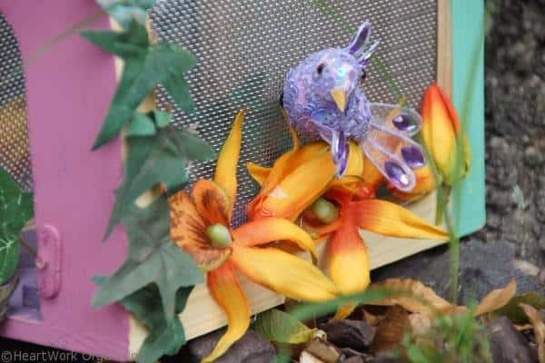 birds atop a fairy house