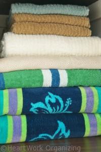 organized towels in bathroom linen closet