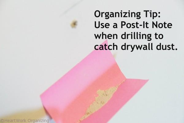 catch drywall dust when drilling with a sticky note