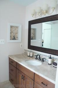 medicine cabinet turned display niche in spa bathroom