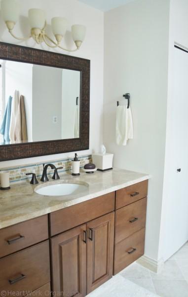 wood vanity with granite top in bathroom renovation