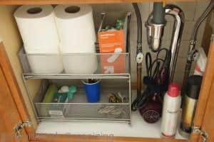 add drawers under a sink for more storage and organization