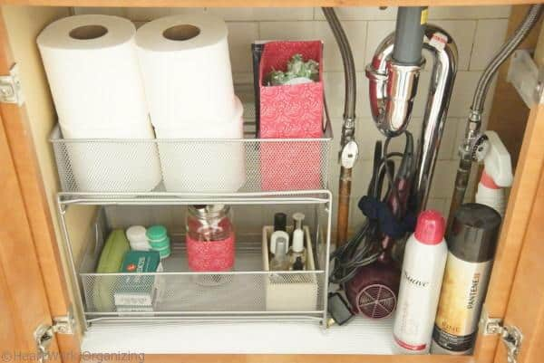 color coordinating accessories when organizing under the bathroom sink