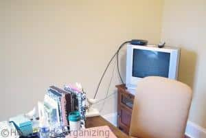 organizing electronic cords in a home office before