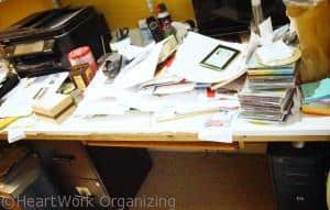 cluttered Home office desk