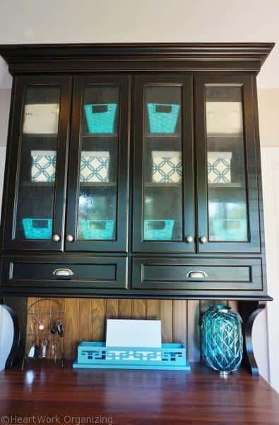 organizing glass fron cabinet