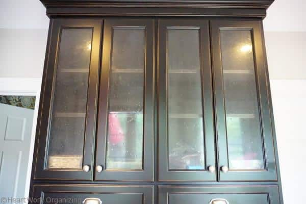 organizing glass front cabinets