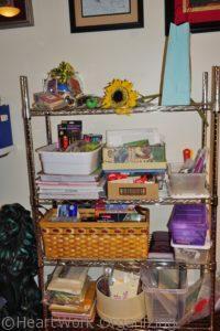 cluttered art room shelves