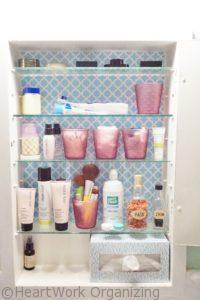 bathroom medicine cabinet organizing with glass cups