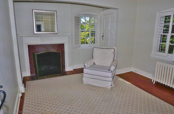 bedroom with fireplace and arch home staging