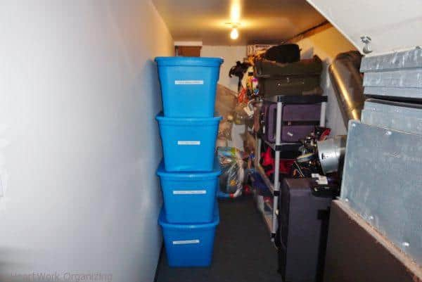 bins stacked in organized basement