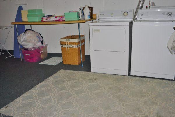 basement laundry area decluttered