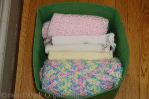 storing baby blankets in a linen closet