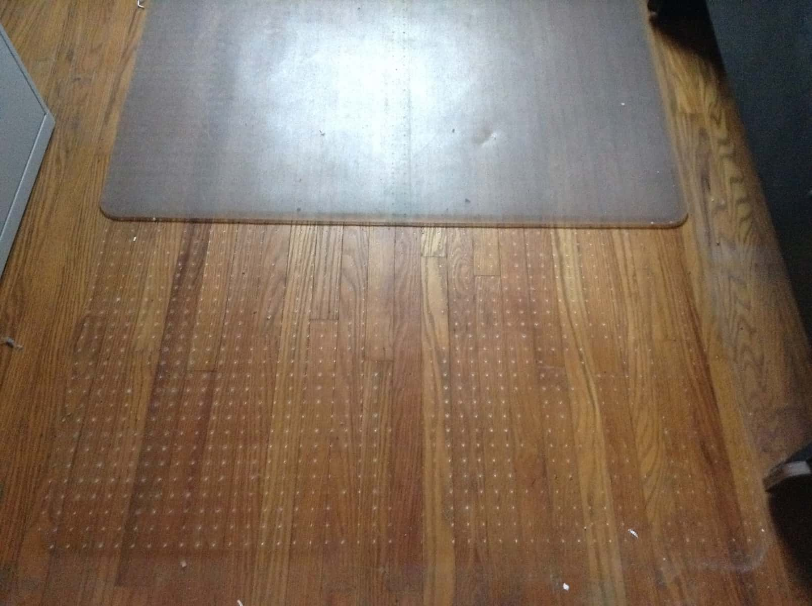 This Damage Will Have To Be Sanded Out And Will Not Be Cheap. Damage From  This Office Chair Mat To These Hardwood Floors Could Have Totally Been  Avoided.