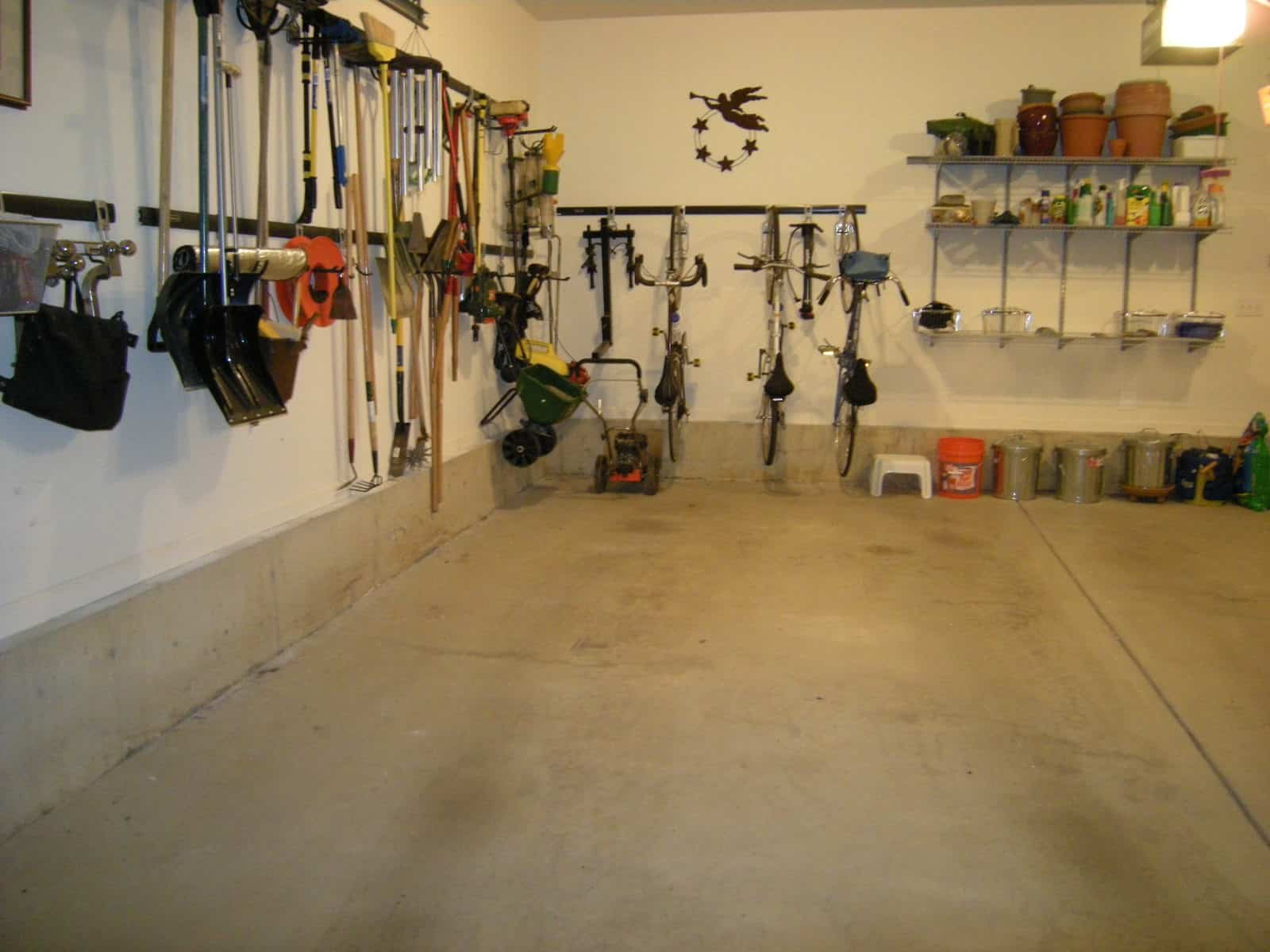 Organized garage zones and nearly everything off the floor.