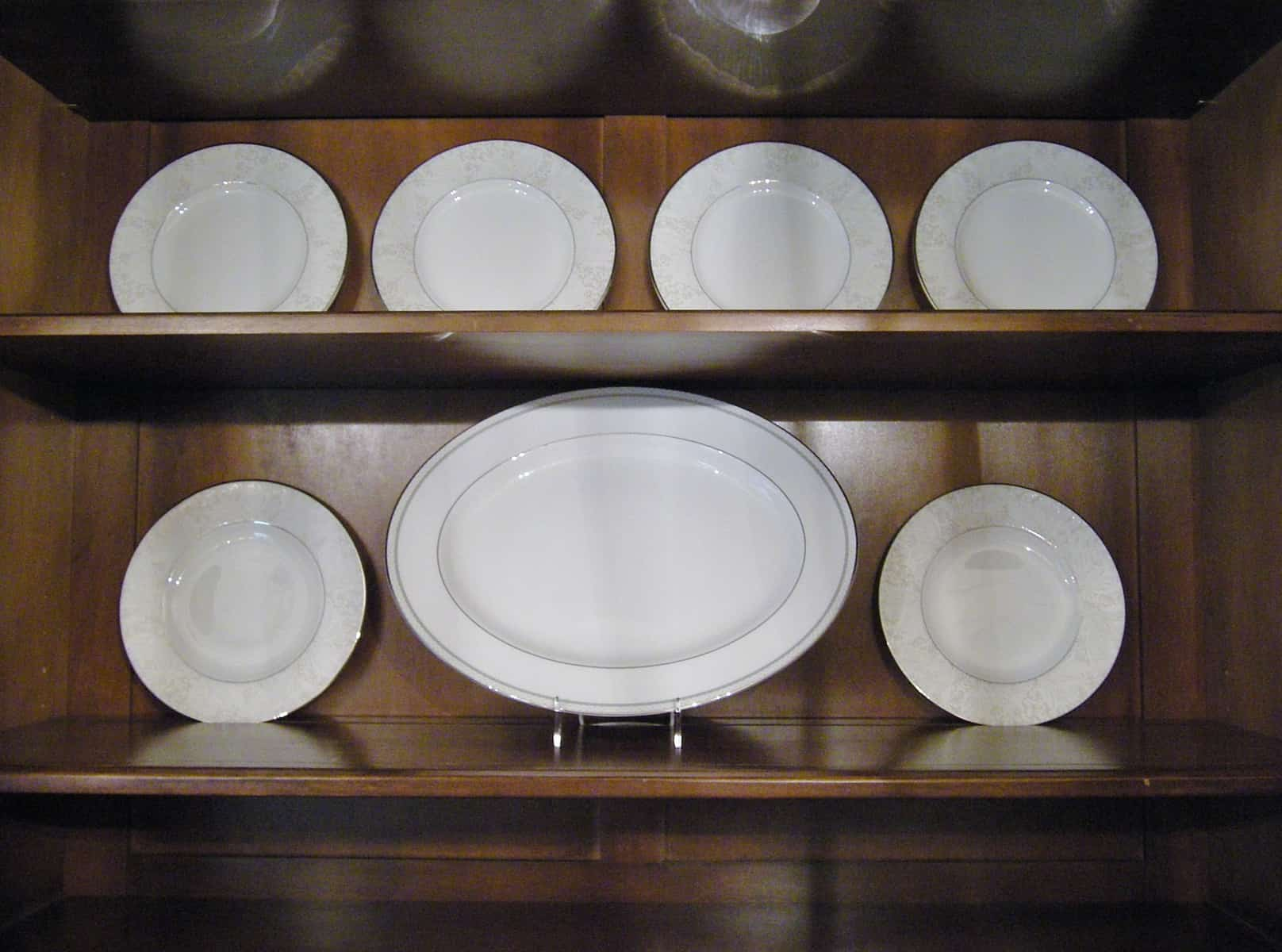Plate stands for china cabinet seeshiningstars for Arranging dishes in kitchen cabinets