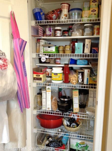 organizing pantry shelves- before