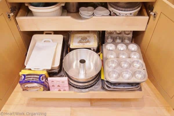 pull out shelf organizes up to 100 pounds