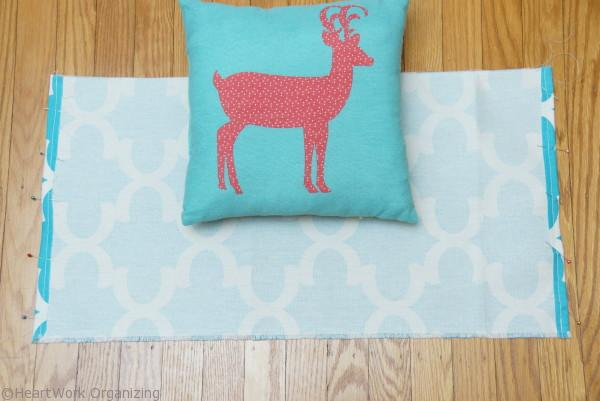 sewing a slipcover to hide a holiday pillow