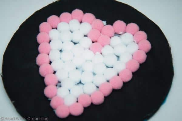 fill in the middle of the Valentine's Day kid craft- pompom coaster