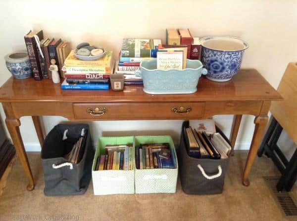 organizing books using pretty fabric bins