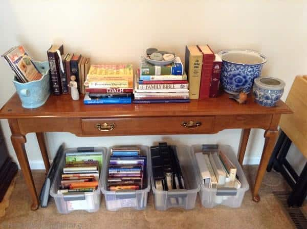 organizing books using plastic bins