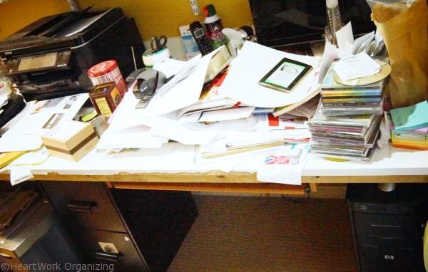 cluttered Home office desk