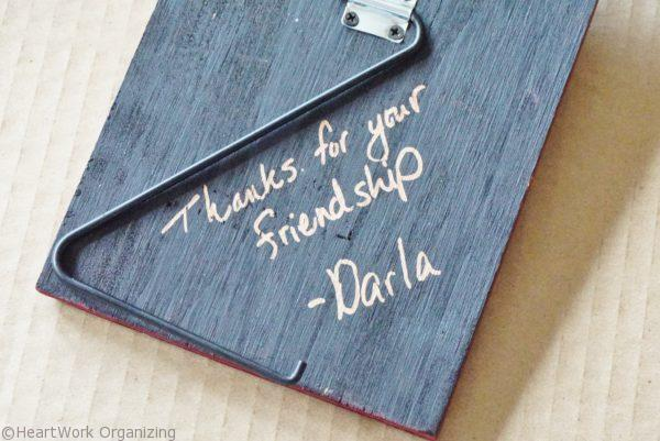 Personalize a photo frame with a Sharpie for a hostess gift