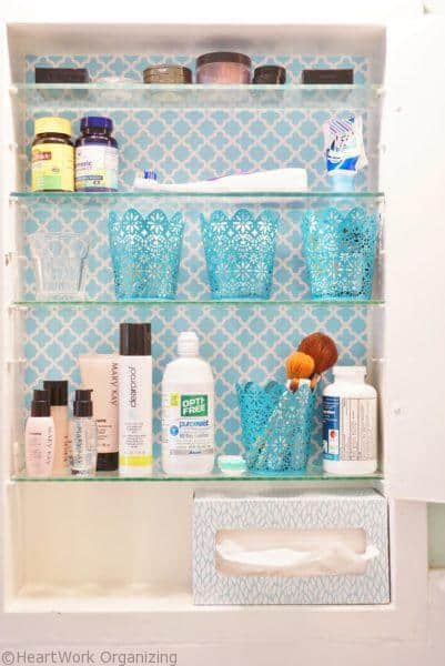bathroom medicine cabinet organizing with metal cups