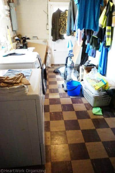 basement laundry room floor before organizing