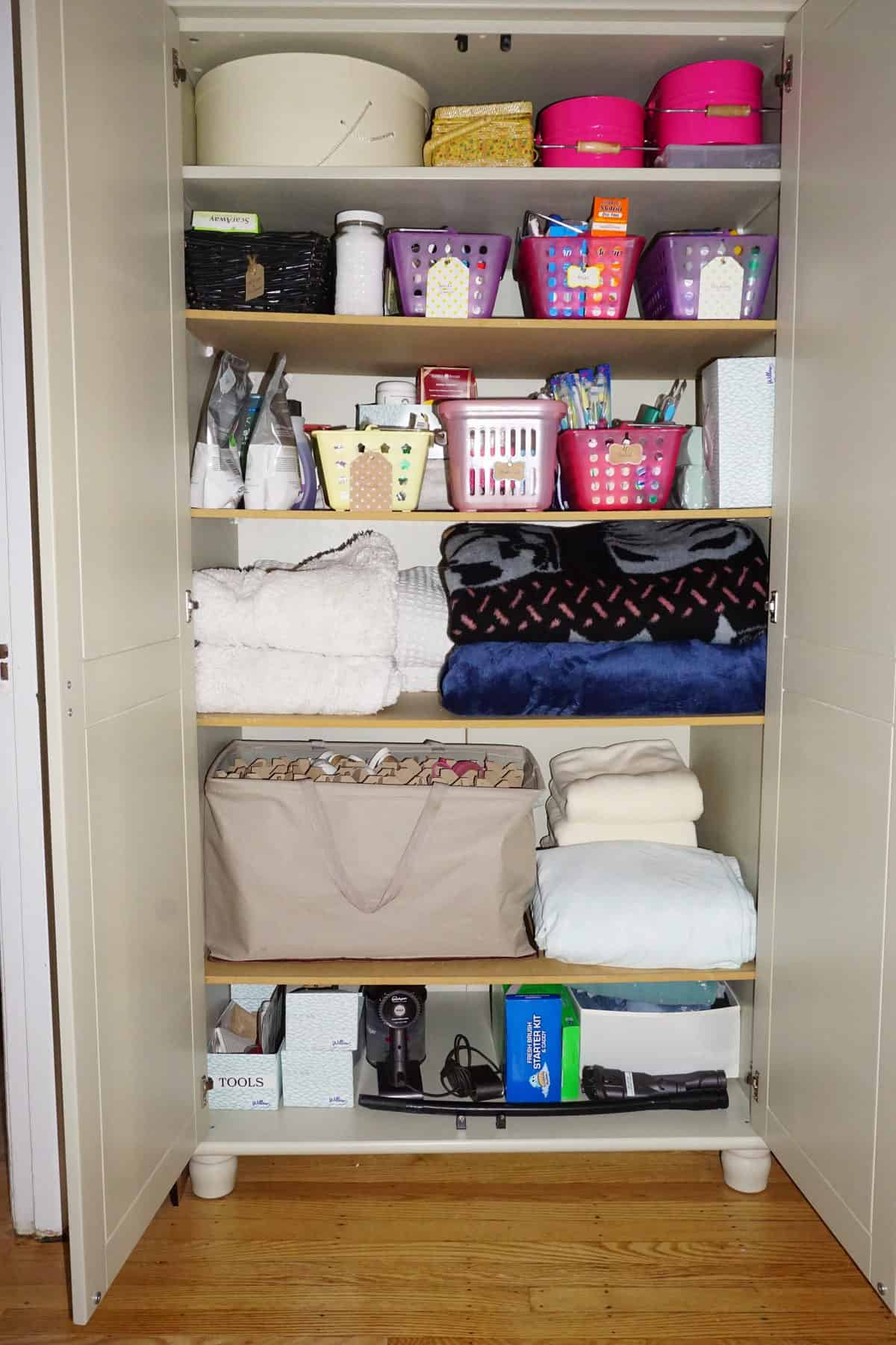 Linen Closet Organizing To Make Room For Kitty