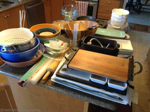 organizing kitchen cabinet by emptying