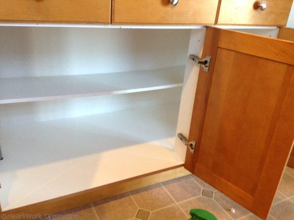 organizing kitchen cabinet by emptying cabinet