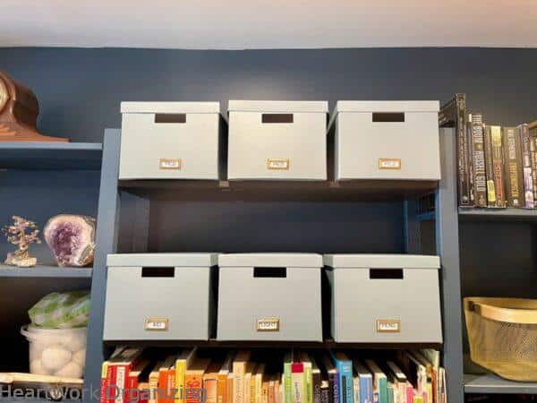 How to Organize a Small Home Without a Closet- boxes for hiding in plain sight